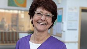 Porträtfoto einer Pflegerin.